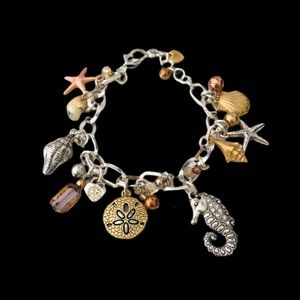 Brighton beach/ocean charm bracelet.  Silver plate